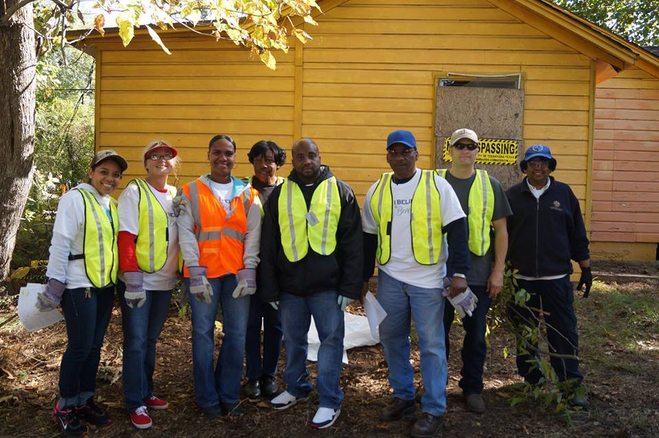 Volunteers in front of wooden building
